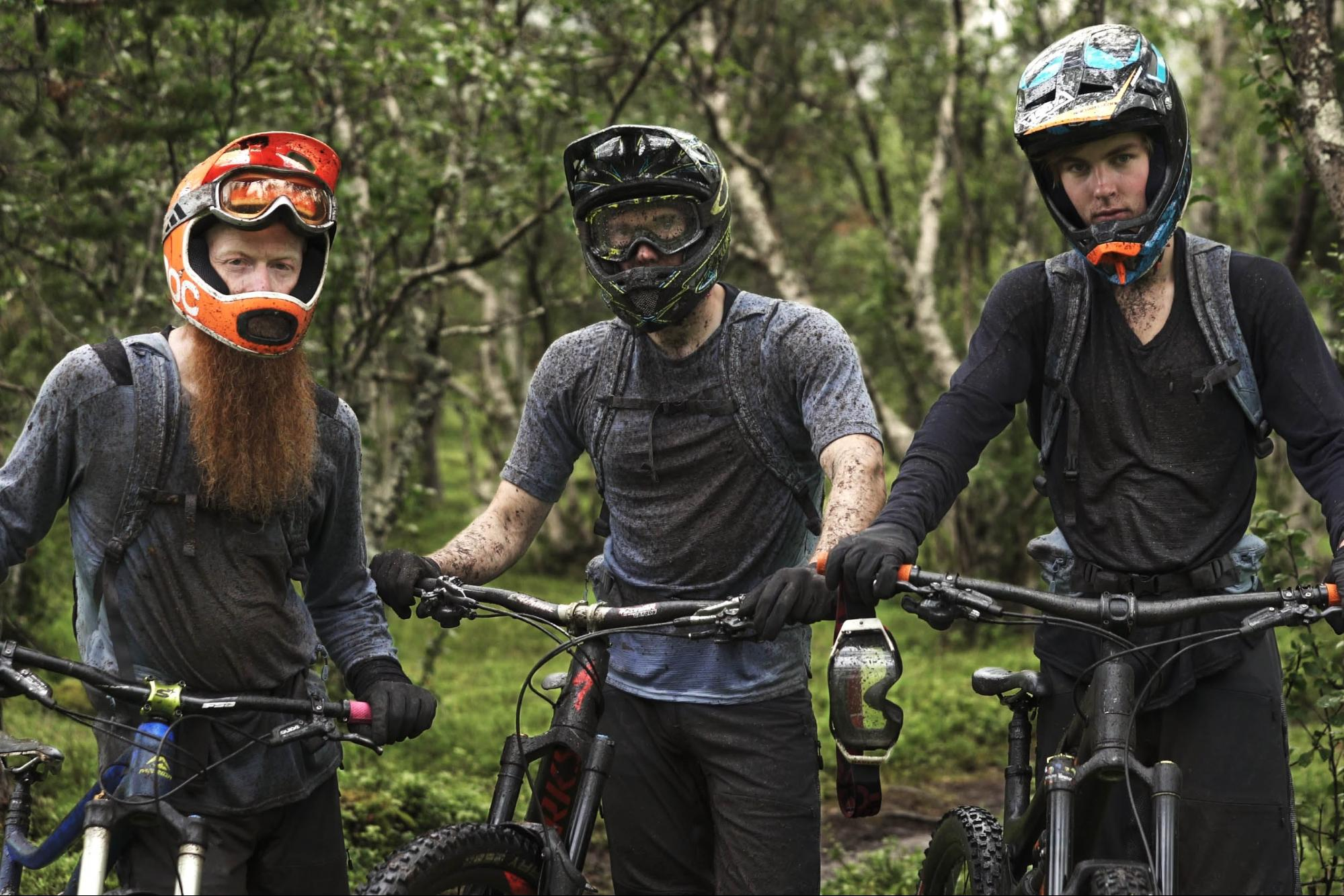 Mountain bikers covered in mud